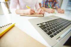 Laptop and notepad Stock Photos