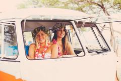 Beach Lifestyle Surfer Girls in Vintage Surf Van - stock photo