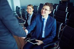 Meeting partner at conference - stock photo