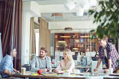 Interaction in office Stock Photos
