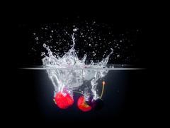 Fruit Splashing into water. - stock photo