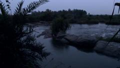 The Kaveri river in South India at night, rising tracking shot Stock Footage
