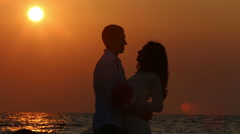 Silhouette of bride embrace groom Stock Footage
