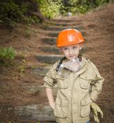 Adorable Child Boy with Big Gloves Playing Handyman Outside - stock photo