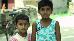 Kids in village in India laughing and smiling together. Narrow depth of field. 6 Stock Footage