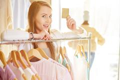 Shopper with discount card - stock photo