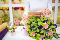 Finishing up floral bouquet - stock photo