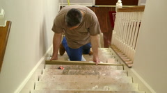 Carpenter fitting in stair riser and measuring for the step Stock Footage
