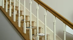 carpenter fitting in new risers to a home staircase - stock footage