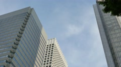 Office buildings and blue sky in Shinjuku district, Tokyo, Japan Stock Footage