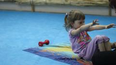Little girl training at the gym Stock Footage