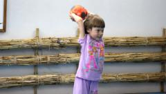 Little girl with a ball in the gym Stock Footage