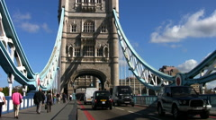 Traffic crossing Tower Bridge in London. - stock footage