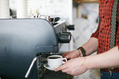 Using coffee machine Stock Photos