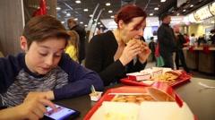 Teenager and sister in Mac Donalds Stock Footage