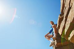 Traveler on rock - stock photo