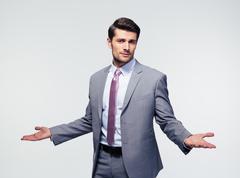 Businessman shrugging shoulders Stock Photos