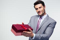 Businessman giving gift box - stock photo