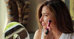 Hispanic Latina caucasian woman doing make up Stock Footage