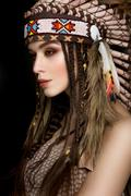 Beautiful ethnic lady with roach on her head - stock photo