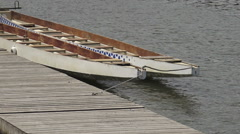 Stock Video Footage of Canoes tied to a wooden dock