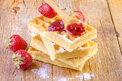 Homemade waffles with strawberry jam Stock Photos