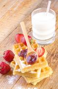 homemade waffles with strawberry jam - stock photo