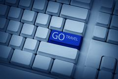 Go Travel Typing On Keyboard Stock Photos