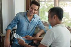 Two Men Using Tablet, Asian Mix Race Friends Guys Stock Photos