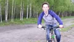 Teenager Boy on Bycicle at Forest Road Stock Footage