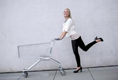 woman with shoppingcart - stock photo