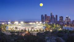 Full moon rising Dodger Stadium downtown Los Angeles city 4K hyperlapse lapse - stock footage