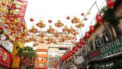 Stock Video Footage of Many red yellow umbrella hang over chinatown street, Petalang area, KL