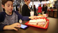 Teenager with Sister at The Mac Donalds Stock Footage