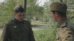 Two young soldier in uniform standing in the forest and smoke Stock Footage