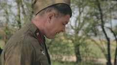 A soldier smokes a cigarette in the forest Stock Footage