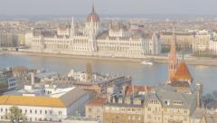Famous Parliament building on Danube river bank tilt 4K 2160p UltraHD footage Stock Footage