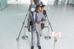Businessman waiting in line - stock photo