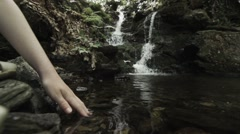 Waterfall hand child in water - stock footage