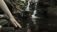 Stock Video Footage of Waterfall hand child in water