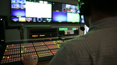 Stock Video Footage of Director broadcast video mixer track left