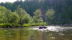 Rafting on the catamaran. River Serga, Urals, Russia. 4K Stock Footage