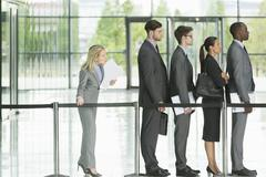 Business people waiting in line Stock Photos