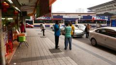 Walk on Jalan Hang Kasturi opposite to bus terminal under Pasar Seni LRT station Stock Footage