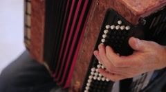 An accordionist is playing the instrument fun fast tune. Stock Footage