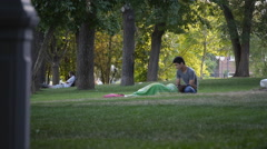 Summer Park Young Peoples On The Grass - stock footage