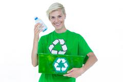 Blonde wearing a recycling tshirt holding recycle box Stock Photos