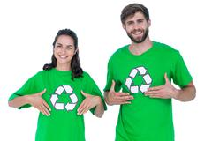 Friends wearing recycling tshirts pointing themselves Stock Photos