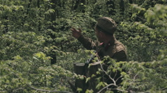 Two soldiers during war with rifles in the forest Stock Footage
