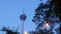 Menara Kuala Lumpur in dusk, panning shot, evening sky, tower head view Stock Footage